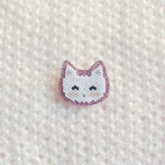 Petit chat sur fond pailleté